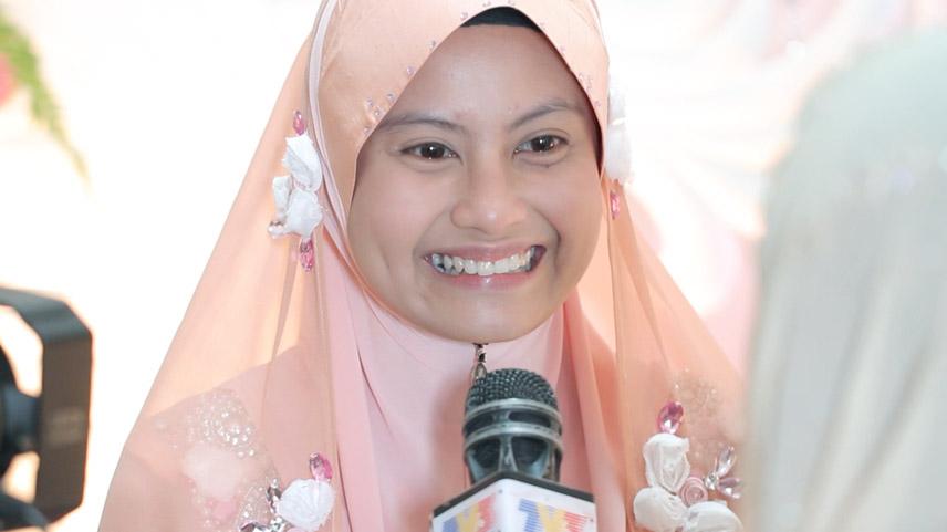 Pakaian khatam Quran bakal isteri Tomok; Siti Rahayu Abas